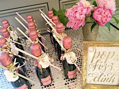 Mini champagne bottle favors from a pink and gold bridal