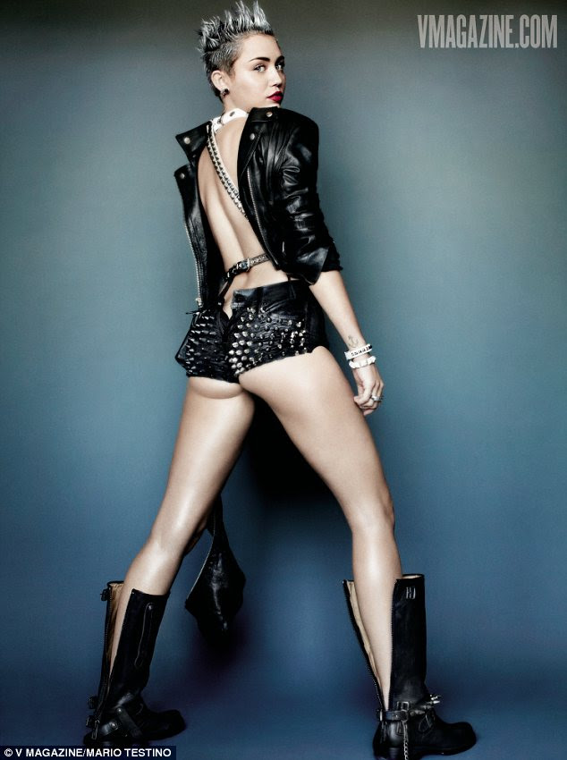 She's definitely not shy: Miley can also be seen in backwards studded shorts and a backwards jacket which are both leather and leave little to the imagination