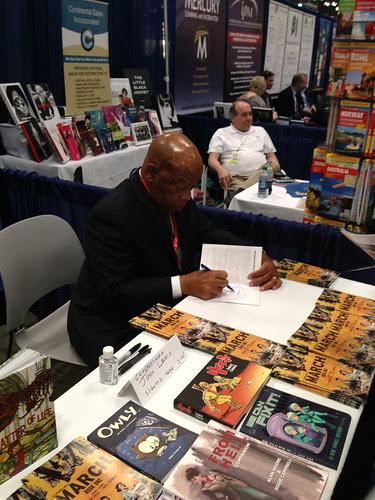 Congressman John Lewis signing a comic book, BEA 2013