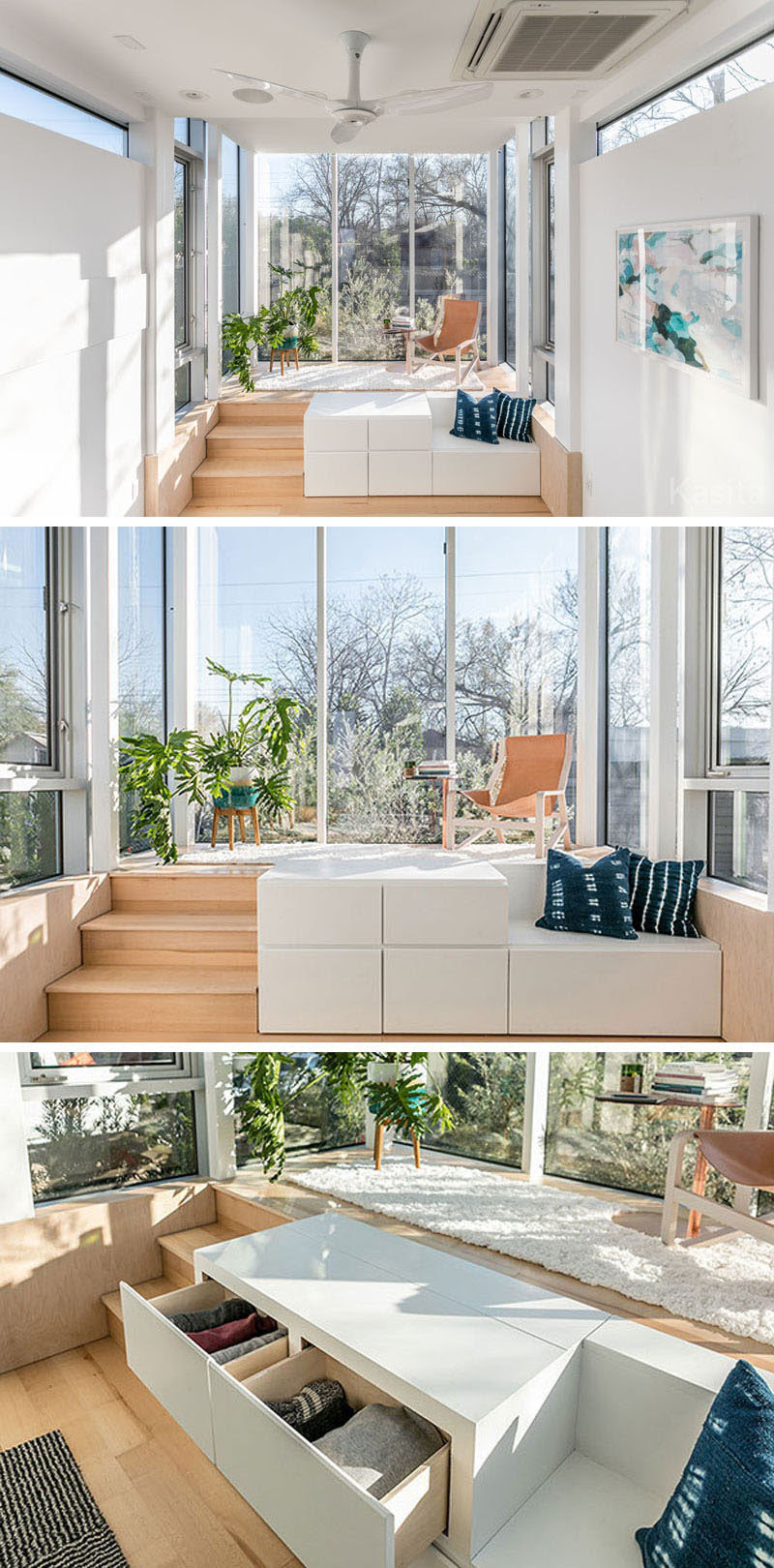 In this modern tiny house, there's a raised platform that's surrounded by floor to ceiling windows, allowing plenty of light to fill the small space. A flat-screen television is hidden within the white storage cube with drawers, that also has a small bench next to it.