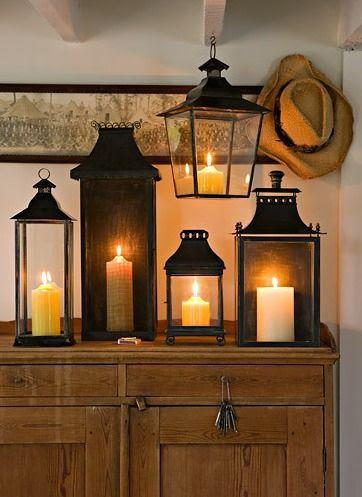 """adore this idea of all the """"lantern"""" candles together and all lit at once. so pretty."""