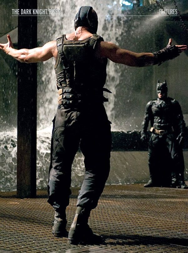 Bane (Tom Hardy) confronts Batman (Christian Bale) in THE DARK KNIGHT RISES. Photo scan is from the January 2012 issue of Empire magazine.