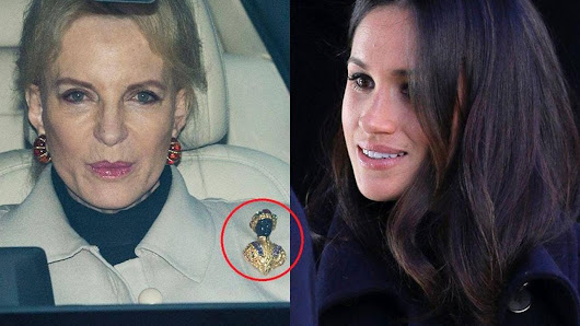 Meghan Markle greeted by Princess Michael of Kent wearing a 'racist' brooch