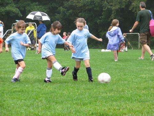 Dova plays soccer in the rain