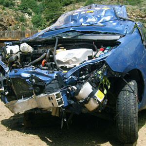 Wrecked Toyota Prius owned by Elizabeth James, photo by Ted James, from Houston Press