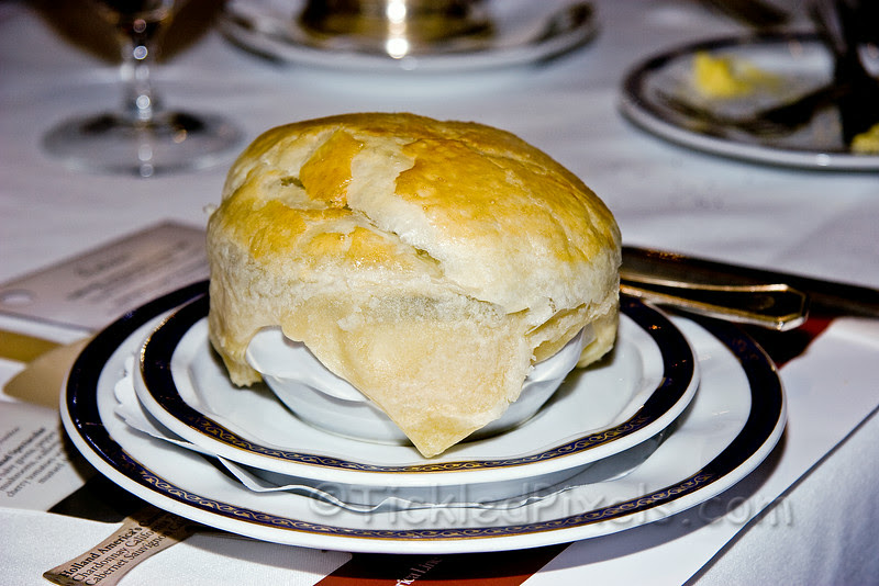 Starters:Oxtail En CrouteFlavorful classical soup slow-simmered and served in a crisp pastry crust