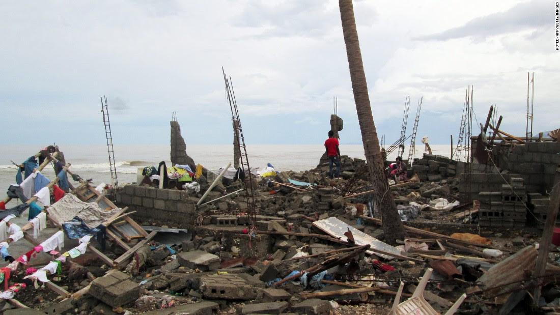 A man walks through the devastated town of Jeremie, west Haiti.
