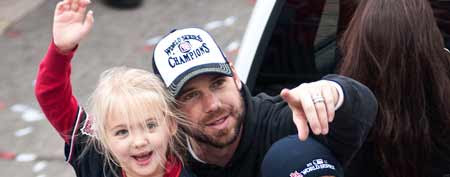 Starting pitcher Chris Carpenter of the St. Louis Cardinals participates in the World Series victory parade with daughter Ava. (Photo by Ed Szczepanski/Getty Images)