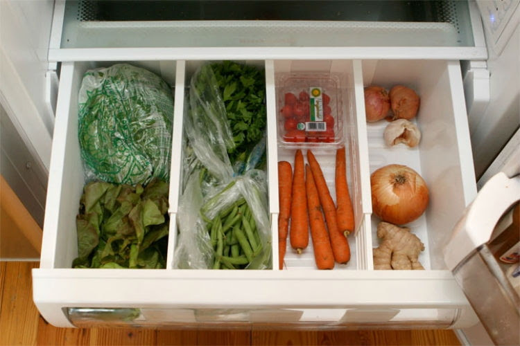 Via EnjoOrganize the vegetable compartment with drawer organizers.y this Beautiful Day