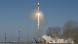 Three crew members representing the United States, Russia and Japan blast off for the International Space Station
