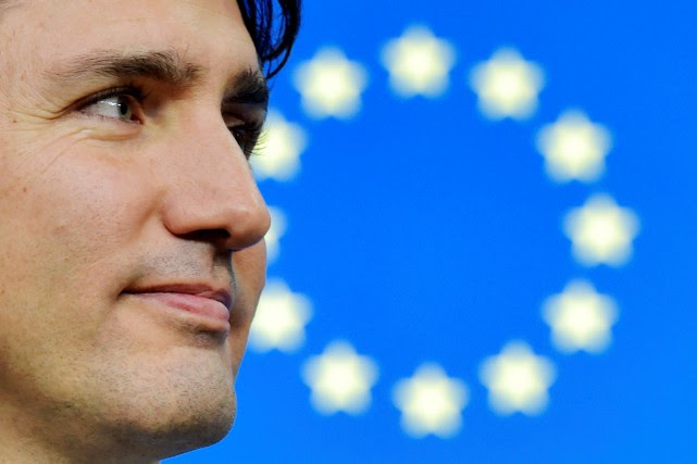 Le premier ministre du Canada, Justin Trudeau, assiste... (REUTERS)