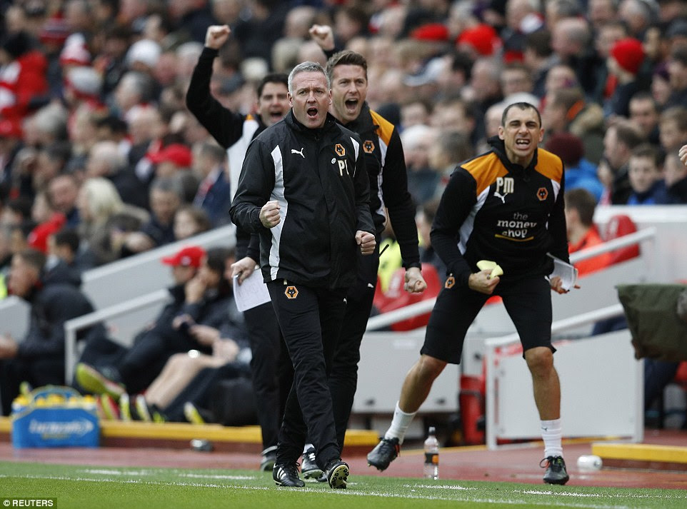 Wolves boss Paul Lambert clenches his fist in celebration on the touchline after seeing his side take an early lead