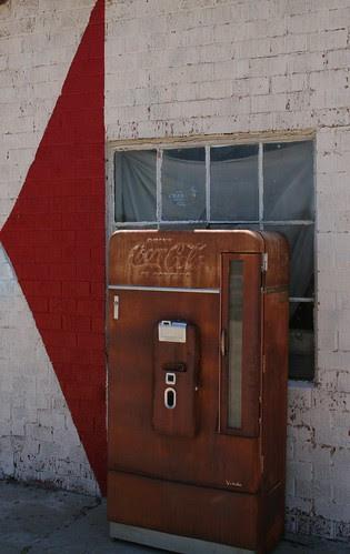 rusty coca-cola machine in adrian
