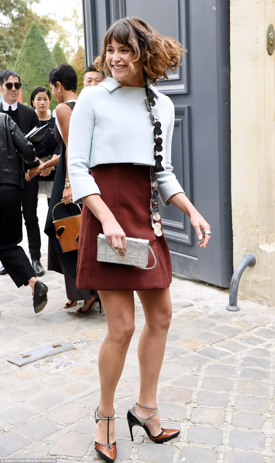 Beaming: Gemma Arterton put in a cheery appearance, in a thigh skimming maroon miniskirt and cropped pale blue jacket