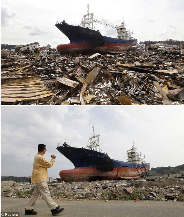 A huge ship that was pushed inland by the 46ft tsunami still rests inland although it is now propped up by wooden posts rather than debris