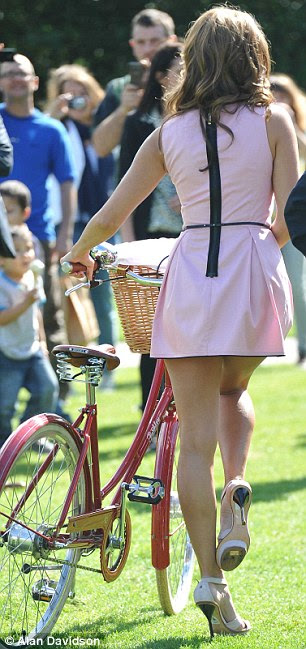 Pretty in  pink: Kelly Brook looked cute in a pale pink and black dress and sky-high heels as she launched London's Sky Ride 2011 today in Potters Fields Park