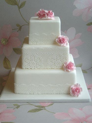 Simple lace doily style wedding cake. Beautiful.   Lace