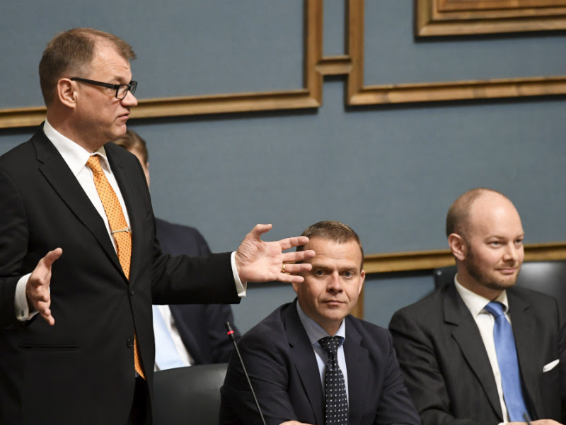 The chairperson of the three ruling parties, Juha Sipilä (Centre), Petteri Orpo (NCP) and Sampo Terho (BR), attended a question-time debate at the Finnish Parliament on 7 June 2018.