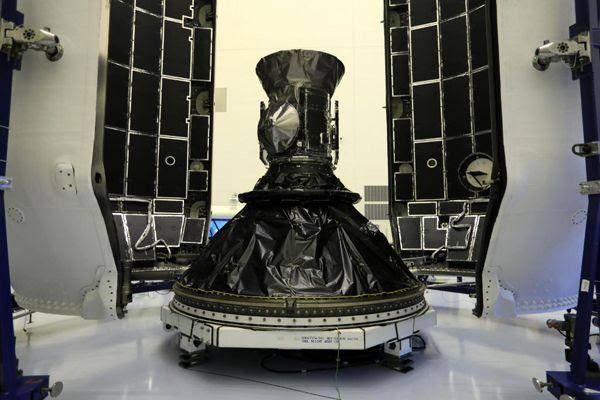 NASA's TESS satellite is about to be encapsulated by the payload fairing for SpaceX's Falcon 9 rocket at Kennedy Space Center in Florida...on April 9, 2018.