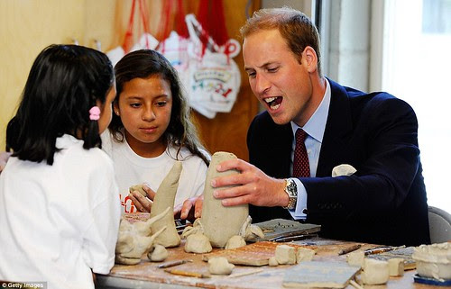 Royal snail  Kate races ahead with her painting at Inner-City Arts  campus whilst William is slow off the mark  7