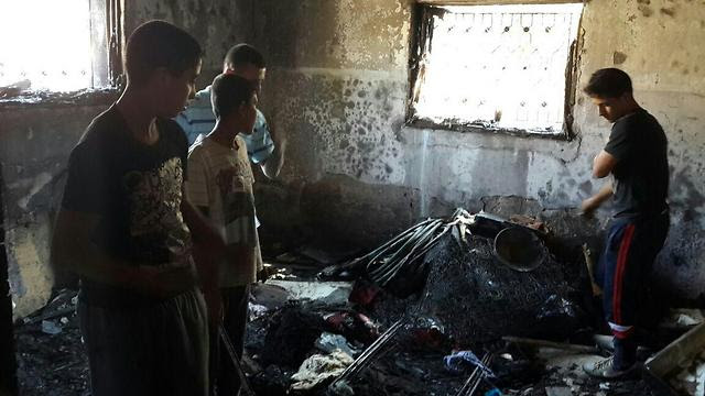 The charred remains of the Dawabsheh family home (Photo: Mohammed Shinawi)