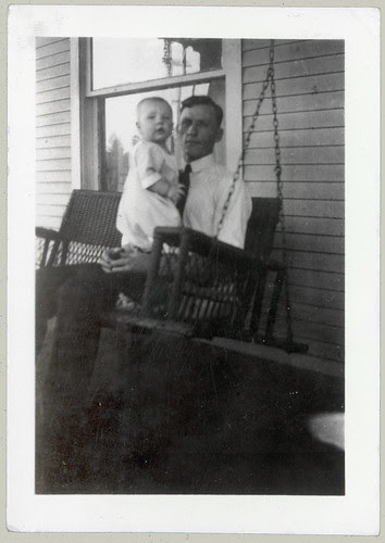 Dad and Baby in porch swing