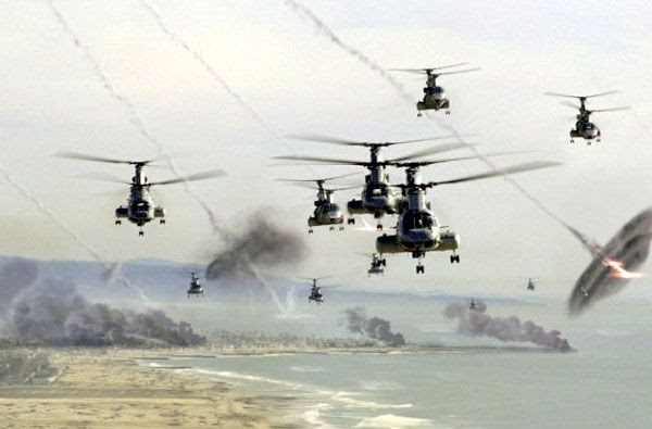 Marine helicopters fly along the Southern California coastline as artificial meteors explode all around them in BATTLE: LOS ANGELES.