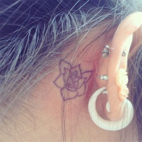 ear tattoo  magnolia    pretty cute