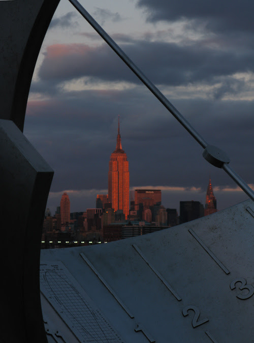 sunset on the Empire State Building seen through a sun dial, Jersey City, NJ