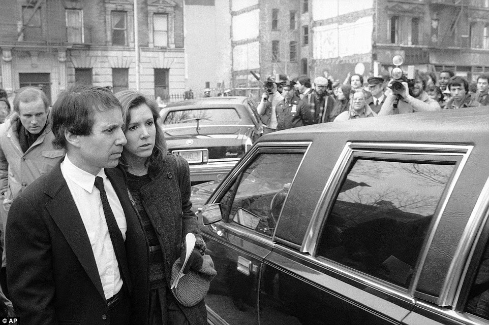 Fisher and Simon first started dating in 1977. They are pictured above in 1982 after a memorial service for comedian John Belushi