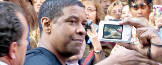 An old woman's prophecy over actor Denzel Washington said he would speak to millions