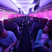 Purple light bathed passengers awaiting takeoff on a Virgin America flight from San Francisco.