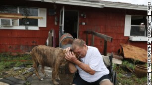 """Steve Culver comforts his dog Otis as he talks about what he said was the """"most terrifying event in his life."""" Hurricane Harvey blew in and destroyed most of his home while he and his wife took shelter there on August 26, in Rockport, Texas. Harvey made landfall shortly after 11 p.m. Friday, just north of Port Aransas, as a Category 4 storm and is the strongest hurricane to hit the United States since Wilma in 2005."""