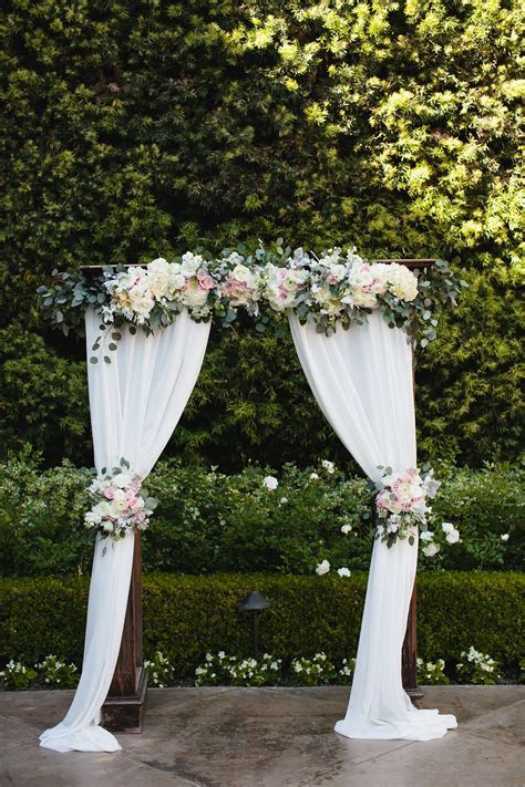Blush and white wedding arch at Franciscan Gardens