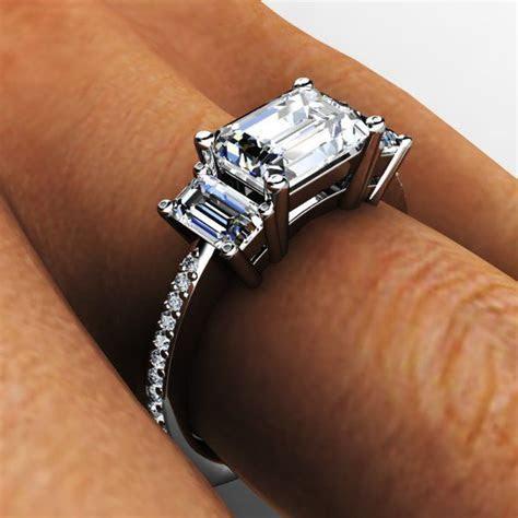 Platinum three stone saddle set diamond emerald cut