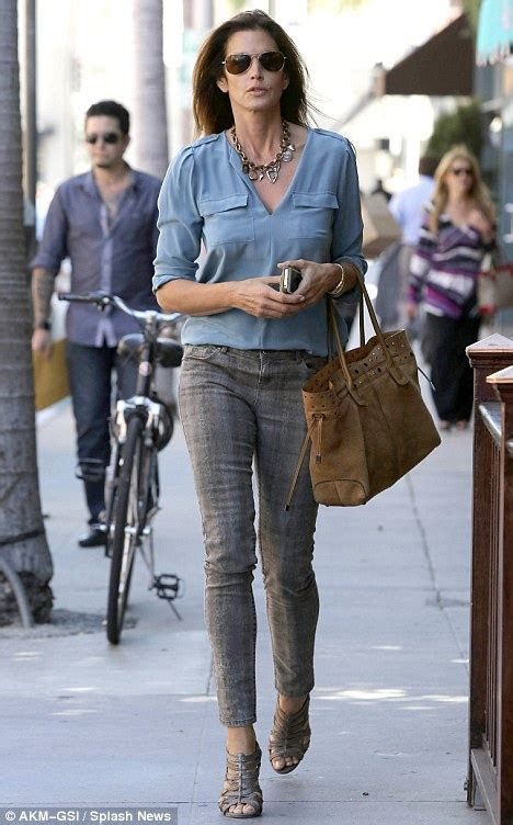 She's still got the look: Cindy Crawford struts her stuff