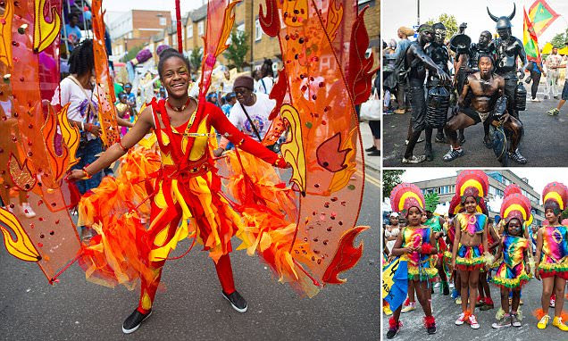 Notting Hill Carnival 2015 revellers ignore downpour warnings