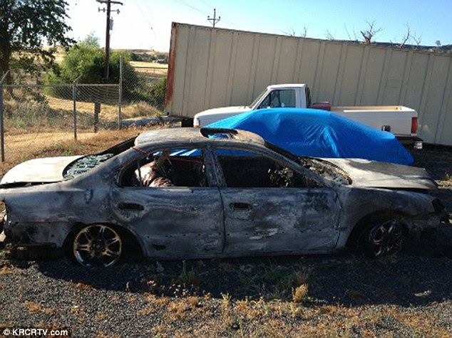 Burnt: Prosecutors said Don Clark burned three people in this once-green 2000 Acura TL after shooting them on his property