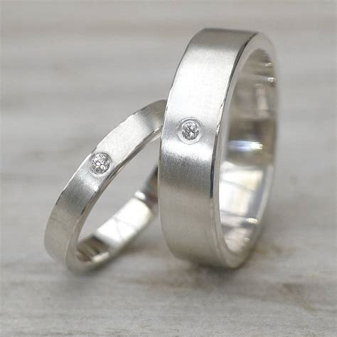 matching diamond silver wedding rings by lilia nash