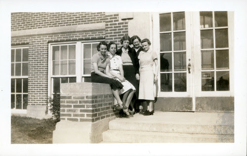 Five women on school steps