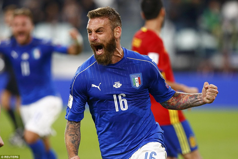 De Rossi does his best Marco Tardelli impression after netting from the spot to earn a 1-1 draw