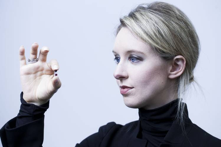 Theranos Inc. founder Elizabeth Holmes holds a 'nanotainer' of blood at the company's headquarters in Palo Alto, Calif., in June 2014.