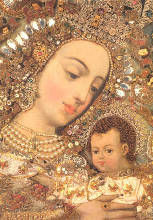 A picture of Our Lady decorated with gold and jewels