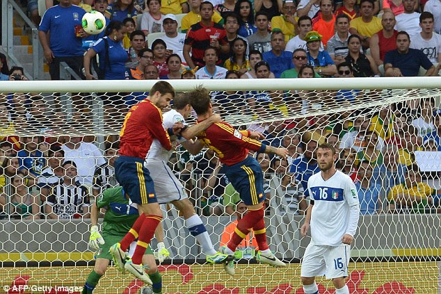 Outnumbered: Italy's Giorgio Chiellini tries to win a header against Sergio Ramos and Gerard Pique