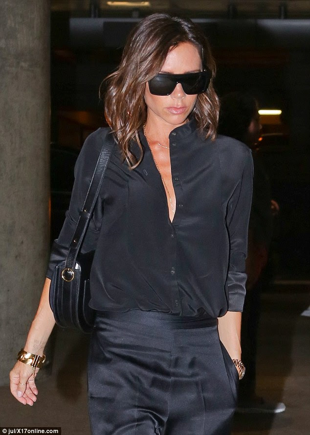 Chest a glimpse! Showing off her incredible figure, Victoria, 42, donned a plunging black blouse that she teamed with a delicate gold necklace, showing off her décolletage
