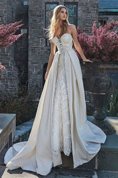 Strapless corset wedding dress with a removable over skirt
