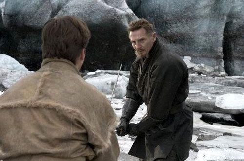 Ra's al Ghul (Liam Neeson) teaches Bruce Wayne (Christian Bale) the ways of a warrior in BATMAN BEGINS.