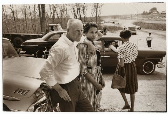 Grey Villet Richard and Mildred Loving watching drag races from the pit area Sumerduck dragway Sumerduck Va 1965