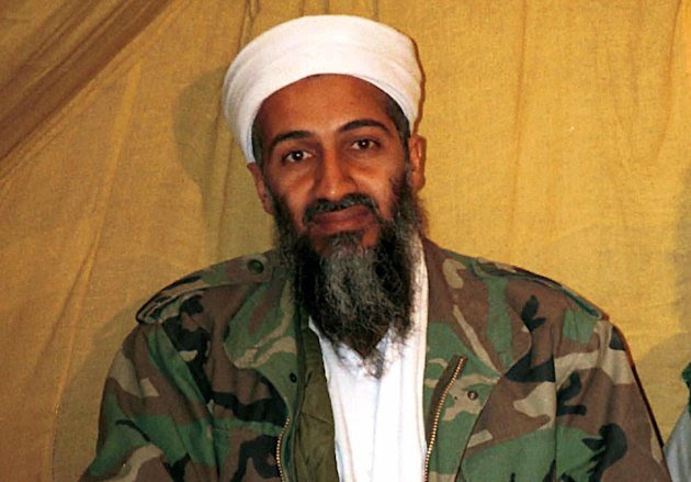 FILE - This undated file photo shows al Qaida leader Osama bin Laden in Afghanistan. Internal emails among senior U.S. military officials reveal that no sailors watched Osama bin Laden's burial at sea from the USS Carl Vinson and traditional Islamic procedures were followed during the ceremony. The emails, obtained by The Associated Press through the Freedom of Information Act, are heavily blacked out, but are the first public disclosure of information about the al-Qaida's leader's death. (AP Photo)