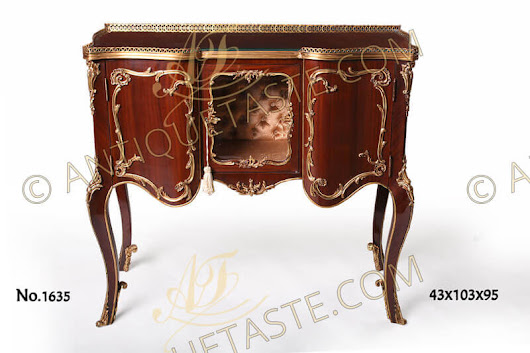 A delicate French Louis XV style ormolu-mounted display cabinet on the manner of François Linke and Léon Messagé late 19th century